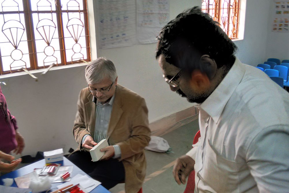 Dr Somdutt Prasad checks medicine packets